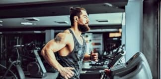 bearded man running on a treadmill