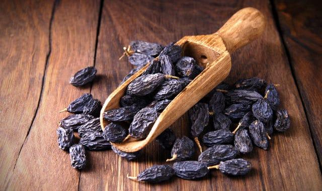 raisins in a wooden scoop