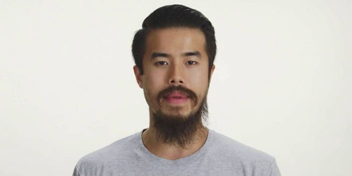 Asian male with grey shirt and thin balbo style beard