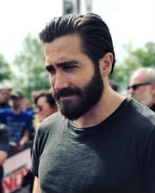 Jake Gyllenhaal with full beard and dark t shirt