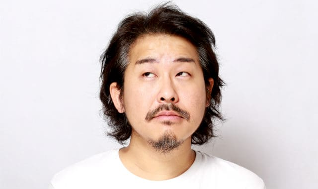asian man with patchy mustache and facial hair on chin