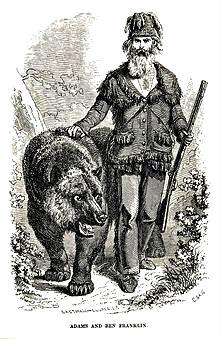 very old painted picture of Grizzly Adams with a gun and a bear beside him.