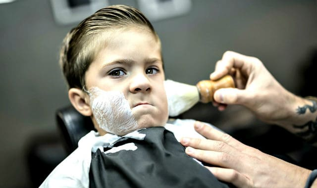 little boy getting a shave