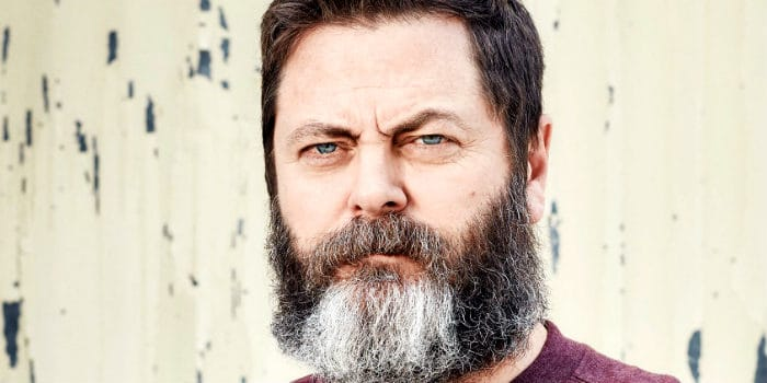 nick Offerman with a full beard on a worn-out background