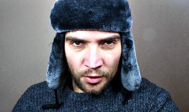 man with short beard and winter hat