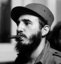 young fidel castro with a cigar in his mouth