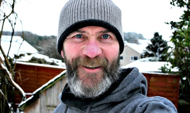 man with full beard outside