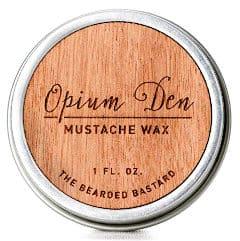 a metal tin of opium den mustache wax isolated
