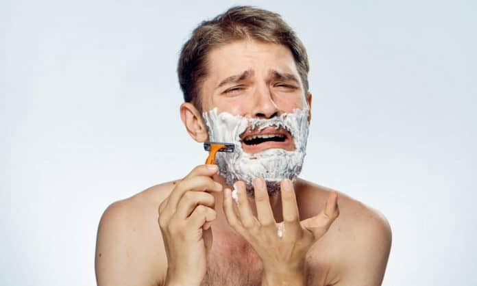 man shaving with razor bumps