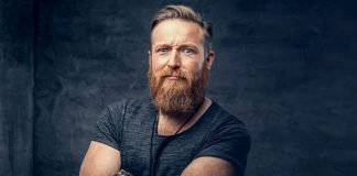 man with cool beard style looking into camera