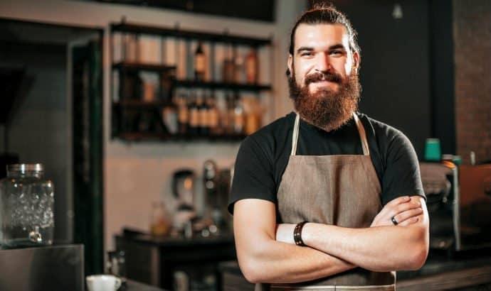 hipster barista with a big bushy beard