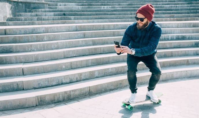hipster man with a beanie on skateboard