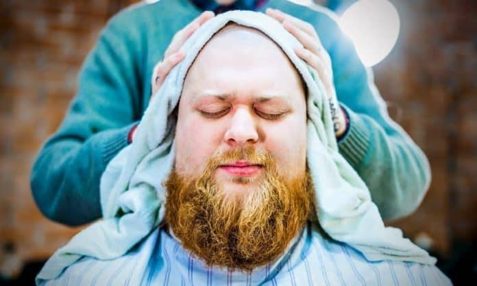 man with split-end beard at barbershop