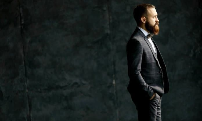 bearded man with a suit