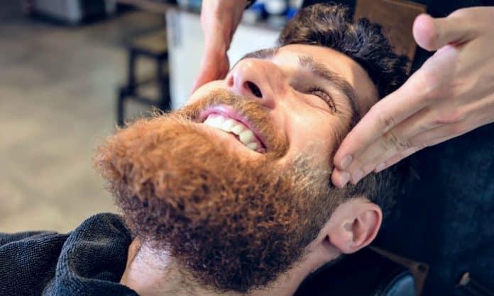 man getting his beard exfoliated