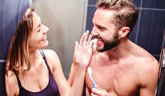 woman looking at his mans beard