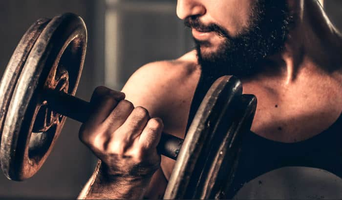 bearded man lifting weights