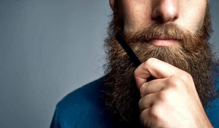 man combing a year long beard