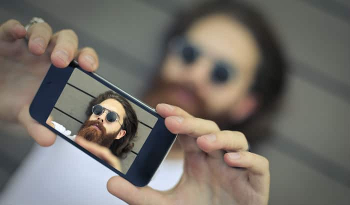 man taking picture of his beard