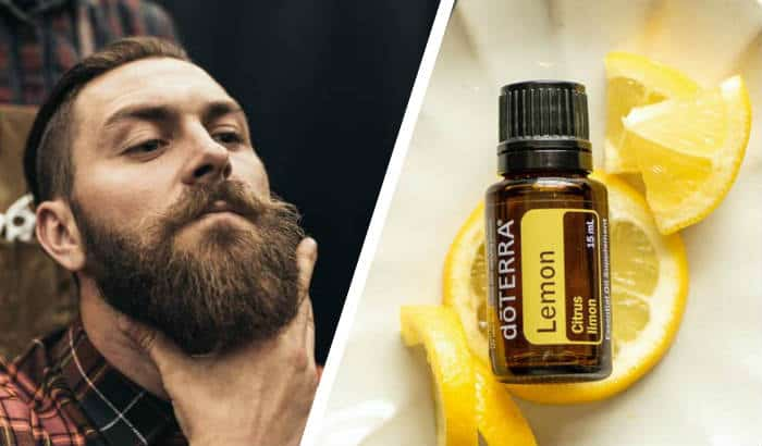 bearded man and bottle of lemon essential oil