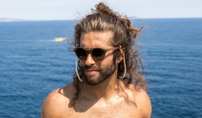 man bun with short boxed beard