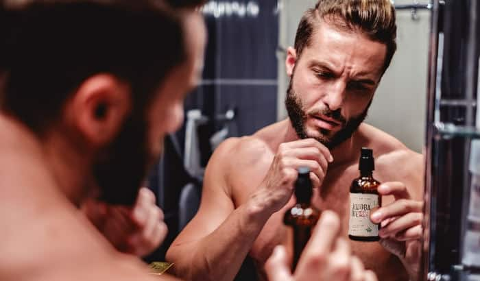man choosing the right jojoba oil for his beard