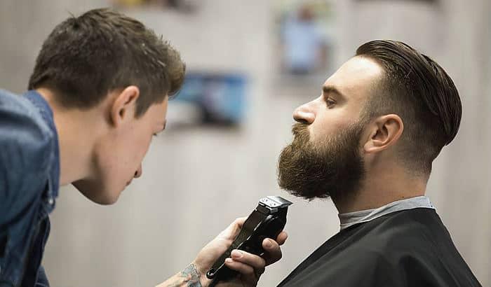 man getting a beard trim with low neckline