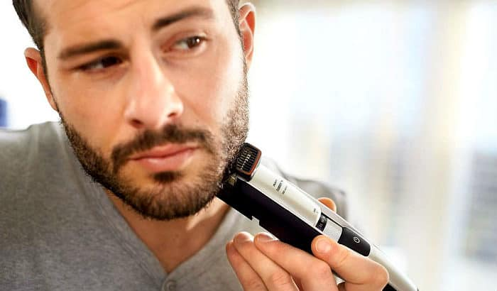 man maintaining a designer stubble with a trimmer