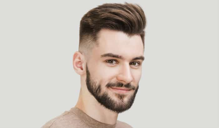 patchy boxed beard with ivy league haircut