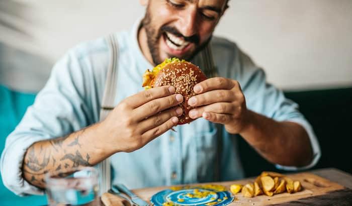 bearded man eating food