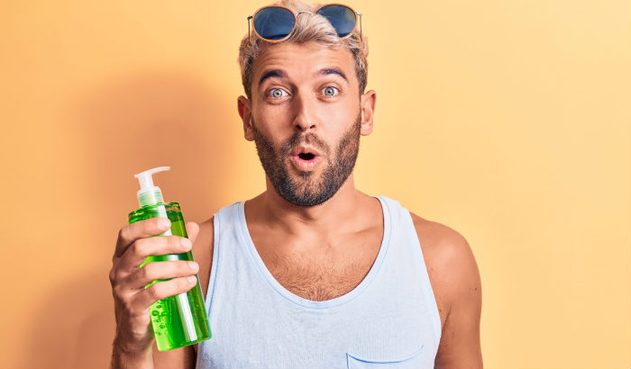 bearded man with aloe vera bottle