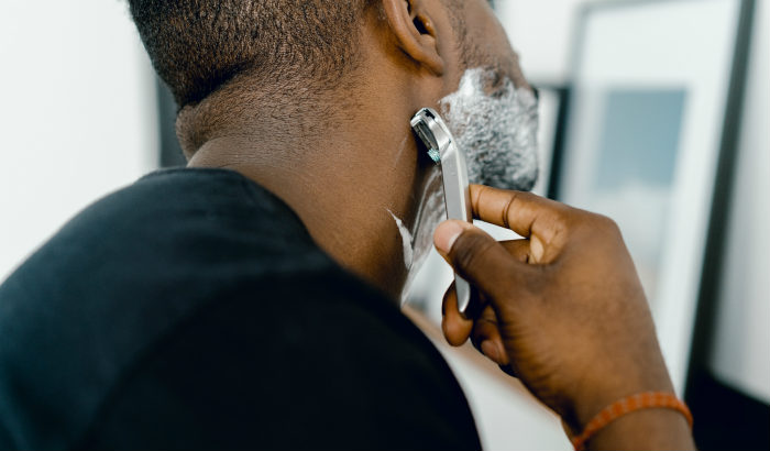 man shaving his neckline