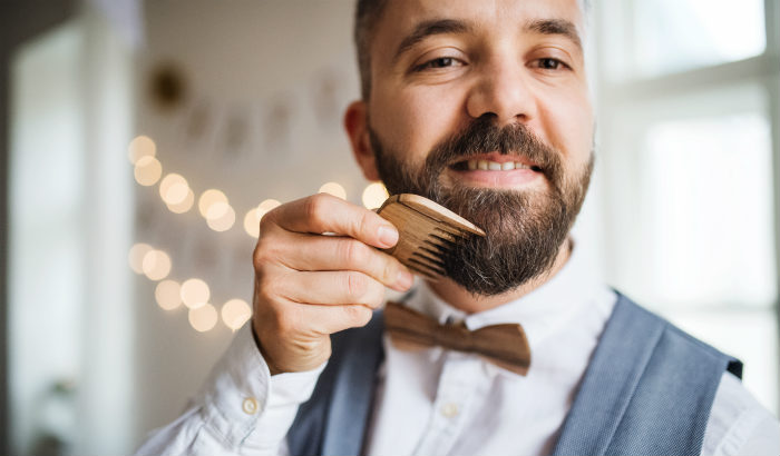sophisticated man with a wooden beard comb