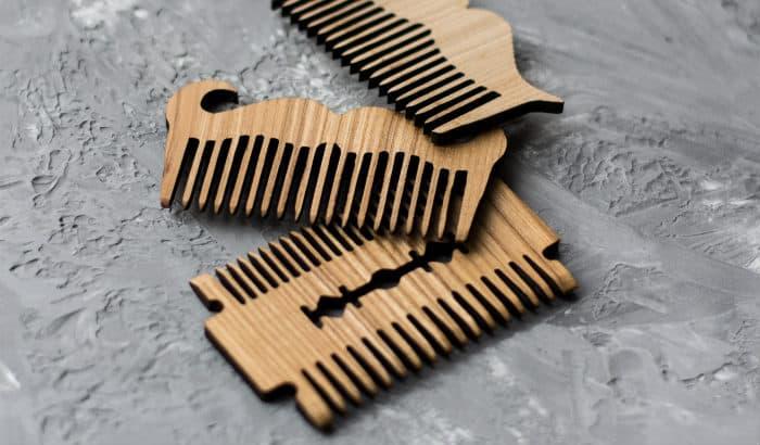 three wooden beard comb designs